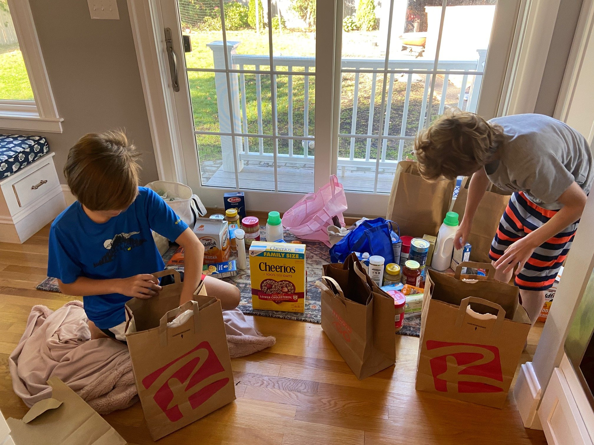 Kence Boys packing B-Love Groceries